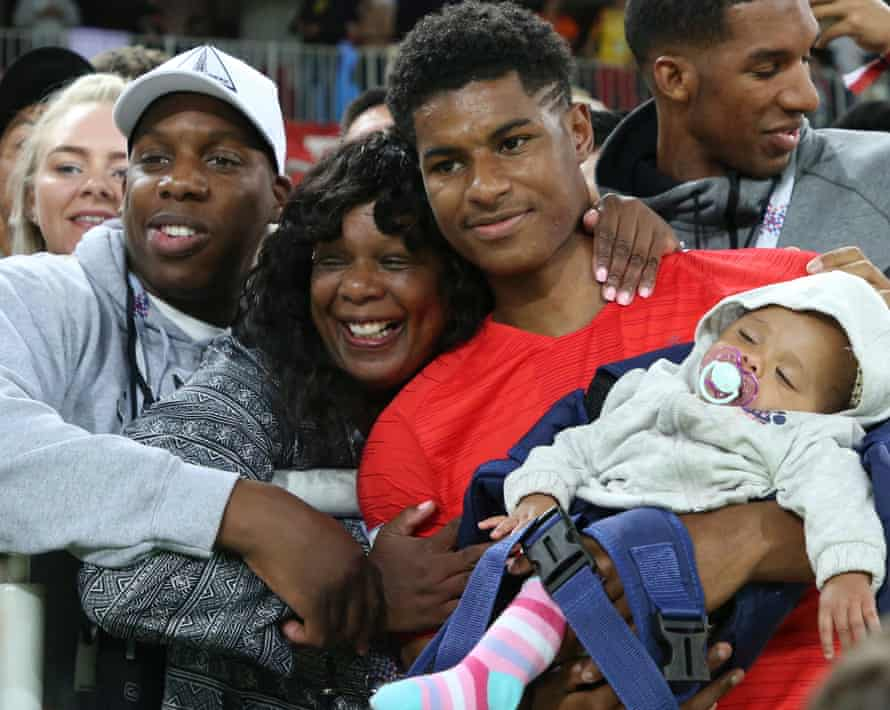 Marcus Rashford of England joins his family following the 2018 FIFA World Cup Russia Round of 16 match between Colombia and England at Spartak Stadium on July 3, 2018 in Moscow, Russia.