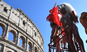 Pride parade participants in front of the Colosseum in Rome.