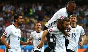 Shkodran Mustafi celebrates scoring the opener for Germany.