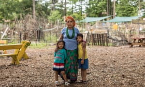 A refugee woman and her children inside the Friends of Refugees community garden in Clarkston, Georgia.