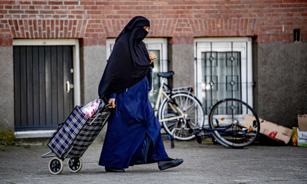 Dutch 'burqa ban' rendered largely unworkable on first day | Netherlands | The Guardian