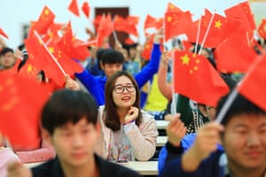 People gather to watch the 19th National Congress of the Communist party of China in Huaibei