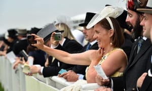 Royal Ascot racegoers enjoy the thrill of the races.