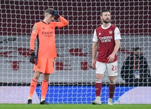 Arsenal's keeper Runar Alex Runarsson and Shkodran Mustafi look dejected after Aymeric Laporte scored Manchester City's fourth goal.