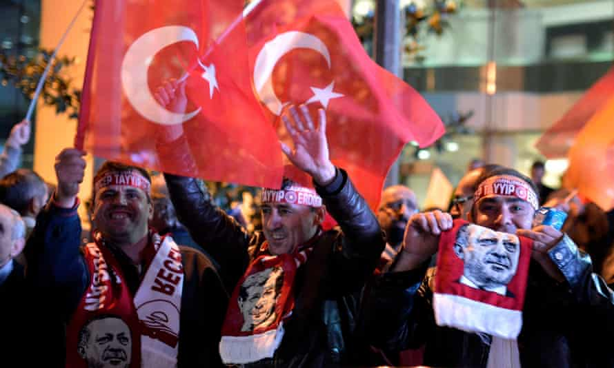 AKP supporters wave flags in front of the party's office in Istanbul