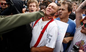 A supporter of rightwing nationalist Richard Spencer is punched during a protest at the University of Florida last month.