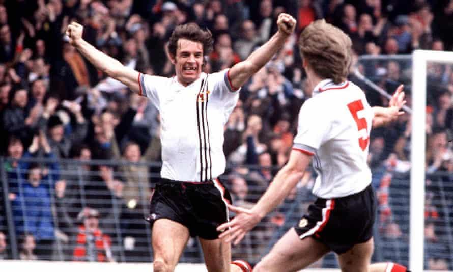 Joe Jordan celebrates a goal for Manchester United with Gordon McQueen