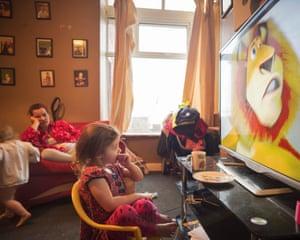 Poppie watching TV with Emma and Pennie behind, Darwen, Oct 2018