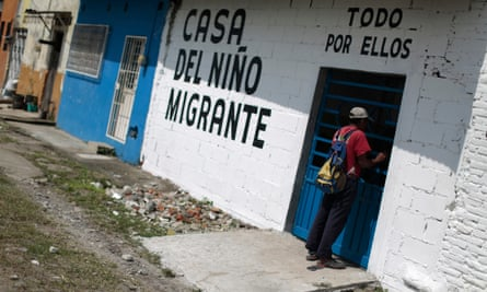 A man stands at the door of the Todo por Ellos (All for Them) migrant shelter in Tapachula, Chiapas, in southern Mexico
