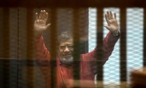 Mohamed Morsi behind bars
