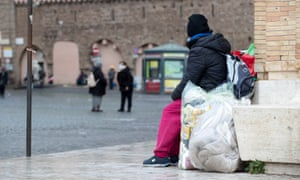 A homeless person living under the colonnade in front of St Peter's Square in Rome.