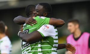 Francois Zoko and Olufela Olomola of Yeovil Town hug at the final whistle.