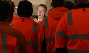 Bill Shorten addresses the workers at the Bombardier factory in Dandenong. Labor has discussed pegging the minimum wage to median earnings to address inequality.