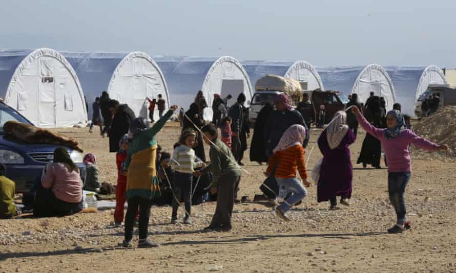Syrian children play at a temporary refugee camp in northern Syria.