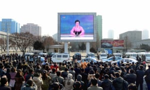 North Koreans watch the news reports of an alleged nuclear test carried out by their government.