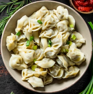 Dumplings with beef and tomato paste. On dark rustic background