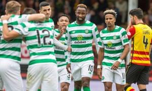 Celtic celebrate after Moussa Dembélé put Celtic back in front at Partick.