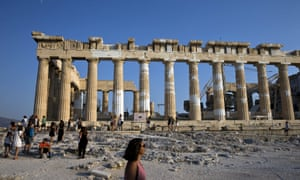 Tourists visit the Parthenon temple at the Acropolis in Athens.
