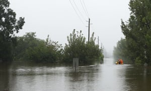 SES workers drive their rescue craft through the flooded Hawkesbury river along Inalls lane in Richmond on 23 March 2021 in Sydney.