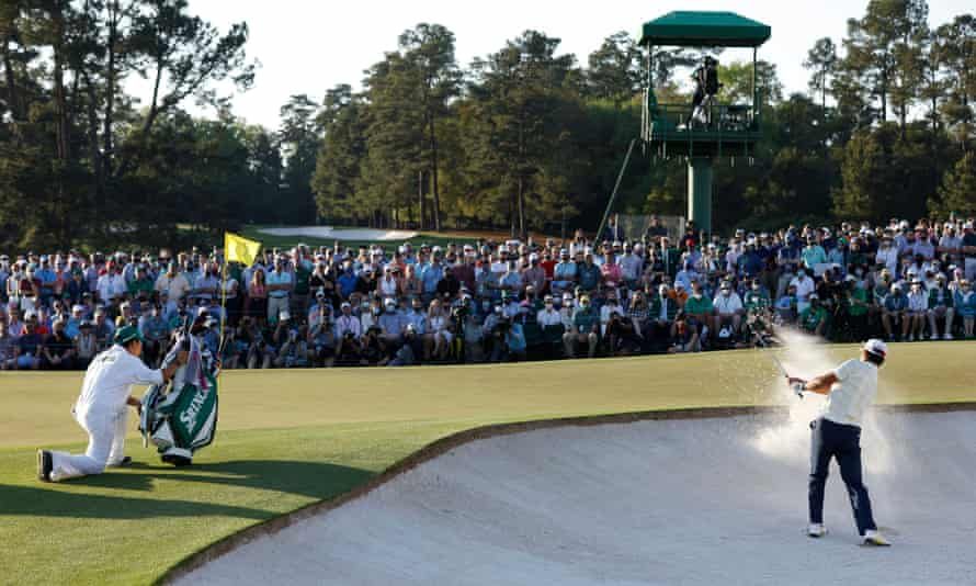 Hideki Matsuyama plays out from the bunker on to the 18th green at Augusta