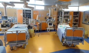 Two beds are seen during a tour for the media of ICU positions for coronavirus patients inside a private clinic in Rome.