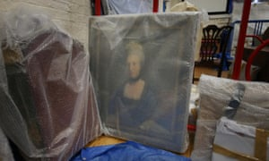 A portrait of Henrietta Shelley, Countess of Onslow, sits wrapped in bubble wrap for protection after being rescued from the blaze.