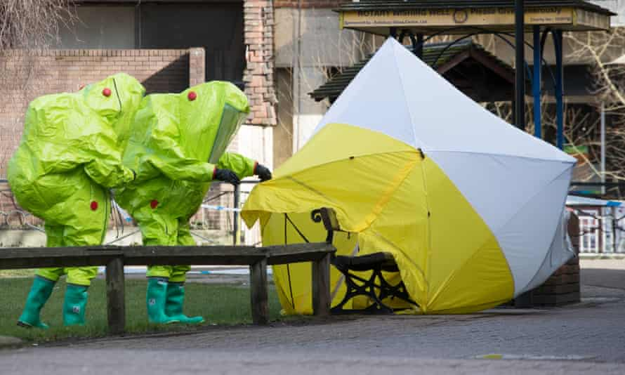 Police in hazmat suits in Salisbury after the poisoning  in 2018