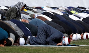 People perform the Friday prayers at Hagley Park.