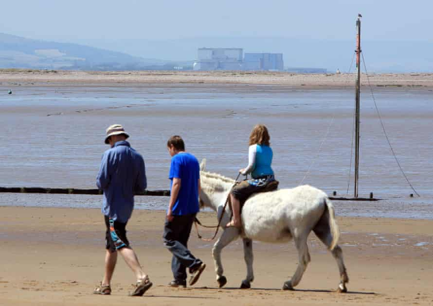 Holidaymakers in Burnham-on-Sea, Somerset, across from Hinkley Point nuclear power station