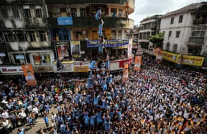 Mumbai, India: Devotees form a human pyramid to break a clay pot containing curd during the Hindu festival of Janmashtami, marking the birthday of Krishna