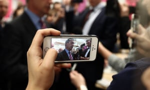 A person takes smartphone footage of Nigel Farage.