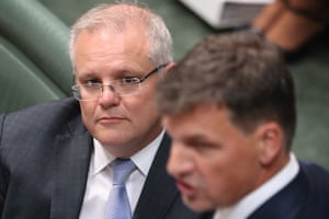 Prime minister Scott Morrison watches Energy minister Angus Taylor during question time