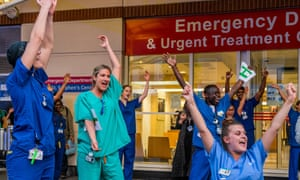 Staff at Chelsea and Westminster hospital, London, being applauded by the public last Thursday.