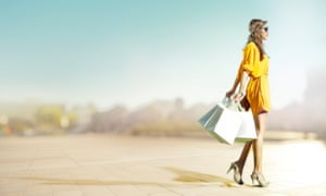 Women wearing expensive clothes and carrying shopping bags