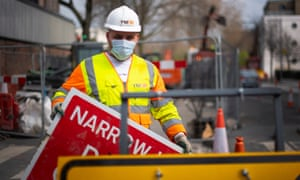A construction worker wearing a protection face mask in Westminster, London as the UK continues in lockdown to help curb the spread of the coronavirus.