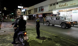rmy officers patrol the streets n Hua Hin, Thailand, on 12 August, after a series of bomb blasts across southern Thailand killed at least four people and injured dozens