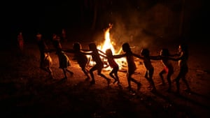 Children play around a campfire during a festival in the Alto Rio Guama indigenous reserve.