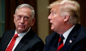 James Mattis listens as Donald Trump speaks to the media in the cabinet room in October 2018.