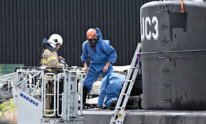 Depth charge: Danish police investigate the recovered submarine Nautilus UC3 in Copenhagen harbour. Peter Madsen is accused of murdering Kim Wall on board.