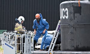 Danish police technicians investigate the recovered privately owned submarine Nautilus UC3.