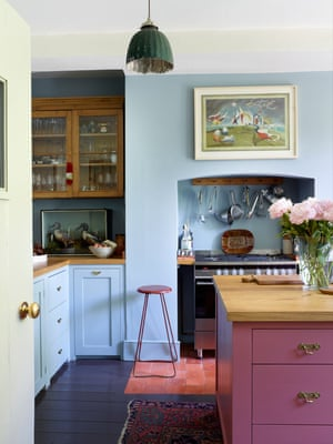 Cool cooks: the blue kitchen with its pink island.