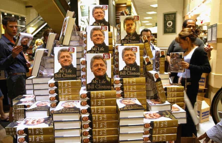 """Bill Clinton's Memoirs Go On Sale At MidnightNEW YORK - JUNE 21: As eager customers wait, Barnes and Noble employees place the new Bill Clinton autobiography """"My Life"""" on the shelves June 21, 2004 in New York City. At 12:01am on June 22, the anticipated book will go on sale throughout America. (Photo by Spencer Platt/Getty Images)"""