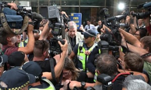 George Pell surrounded by press pack outside court