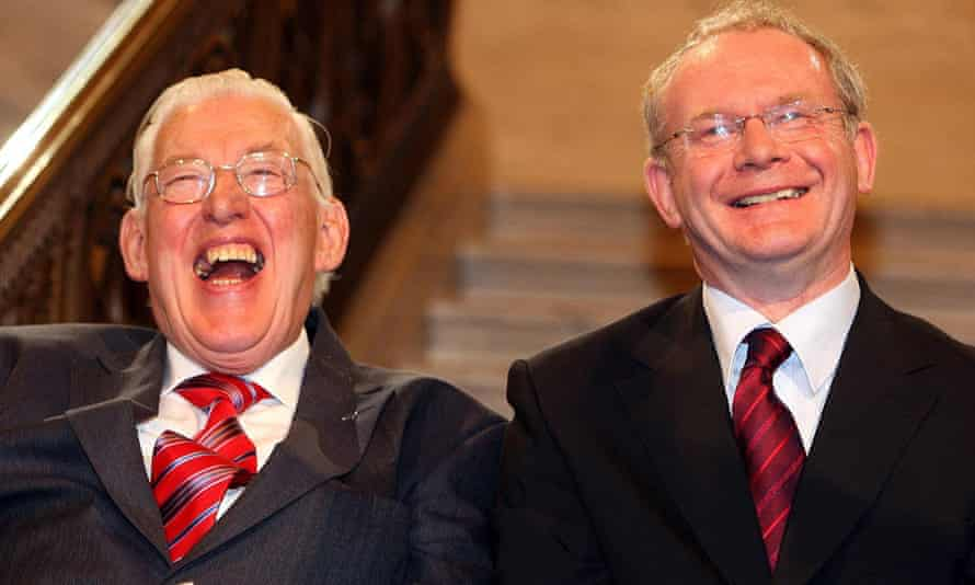 Northern Ireland's first minister Ian Paisley, left, and deputy first minister Martin McGuinness smile after being sworn in at the Northern Ireland Assembly in Stormont in May 2007.