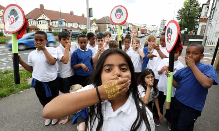 Pupils from Bowes Primary School in Enfield, north London campaign outside their school, which is adjacent to the busy North Circular ring road
