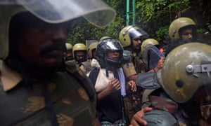 Police officers escorting Fathima (centre) when she made an attempt to enter the Sabarimala temple.