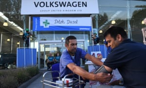 Greenpeace air pollution campaigners and medical professionals have blocked Volkswagen staff from entering the company's head office in Milton Keynes.
