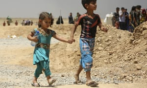 Displaced families flee Islamic State-held towns and villages south of Mosul. The anti-Isis coalition is anxious to ensure the recapture of Mosul does not lead to infighting.