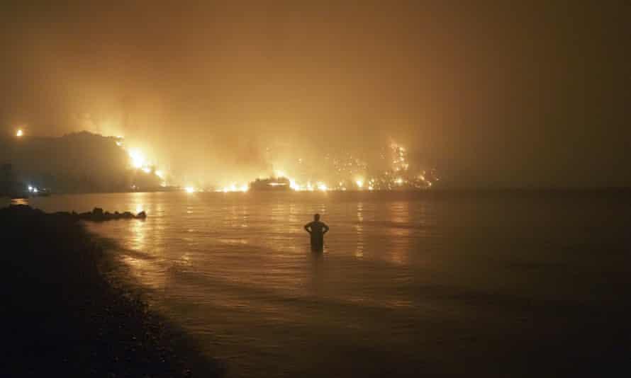A wildfire approaches Kochyli beach near Limni, on Evia, Greece.