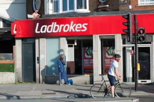 During the coronavirus pandemic lockdown people are finding alternative places to sunbathe, read and relax. This chap was sunbathing on a tiny roof above Ladbrokes betting shop near Kennington